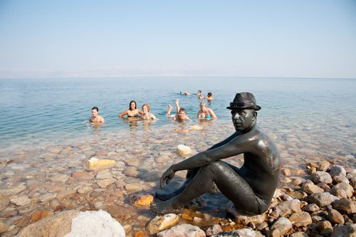 cover with mud - the dead sea